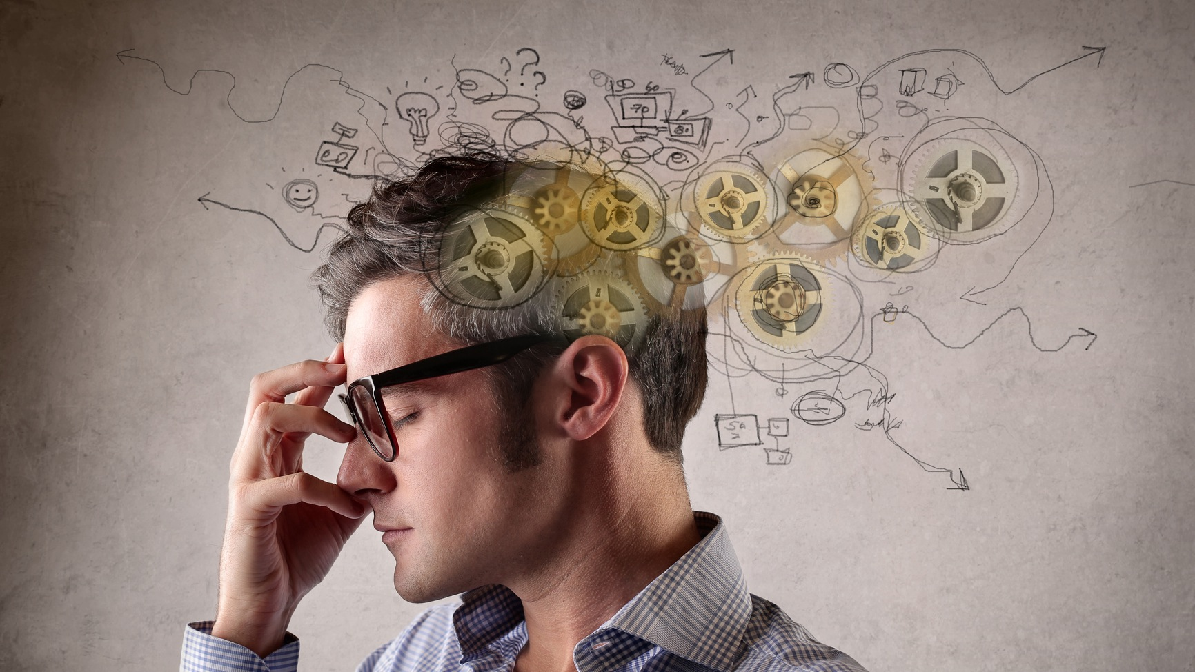 Stressed man witht hand on face and cartoon-like scribbles of gears and frustration marks around his head