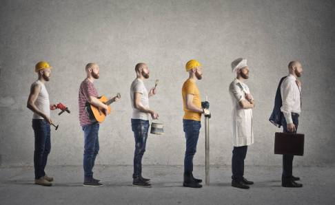 Same man but in the outfits of six different careers: handyman, musician, painter, construction worker, chef, business man