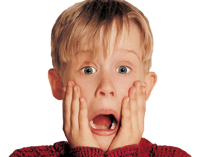 Image of actor Macaulay Culkin playing Kevin McCallister from Home Alone with his hands on his face and his mouth open, as if screaming