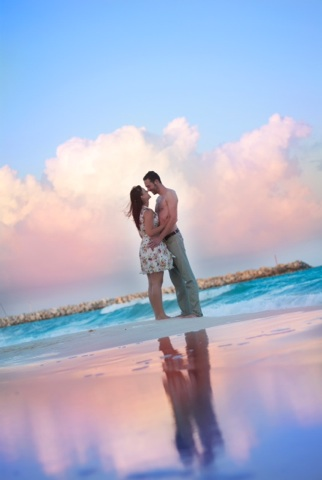 Couple embracing on beach in sunset