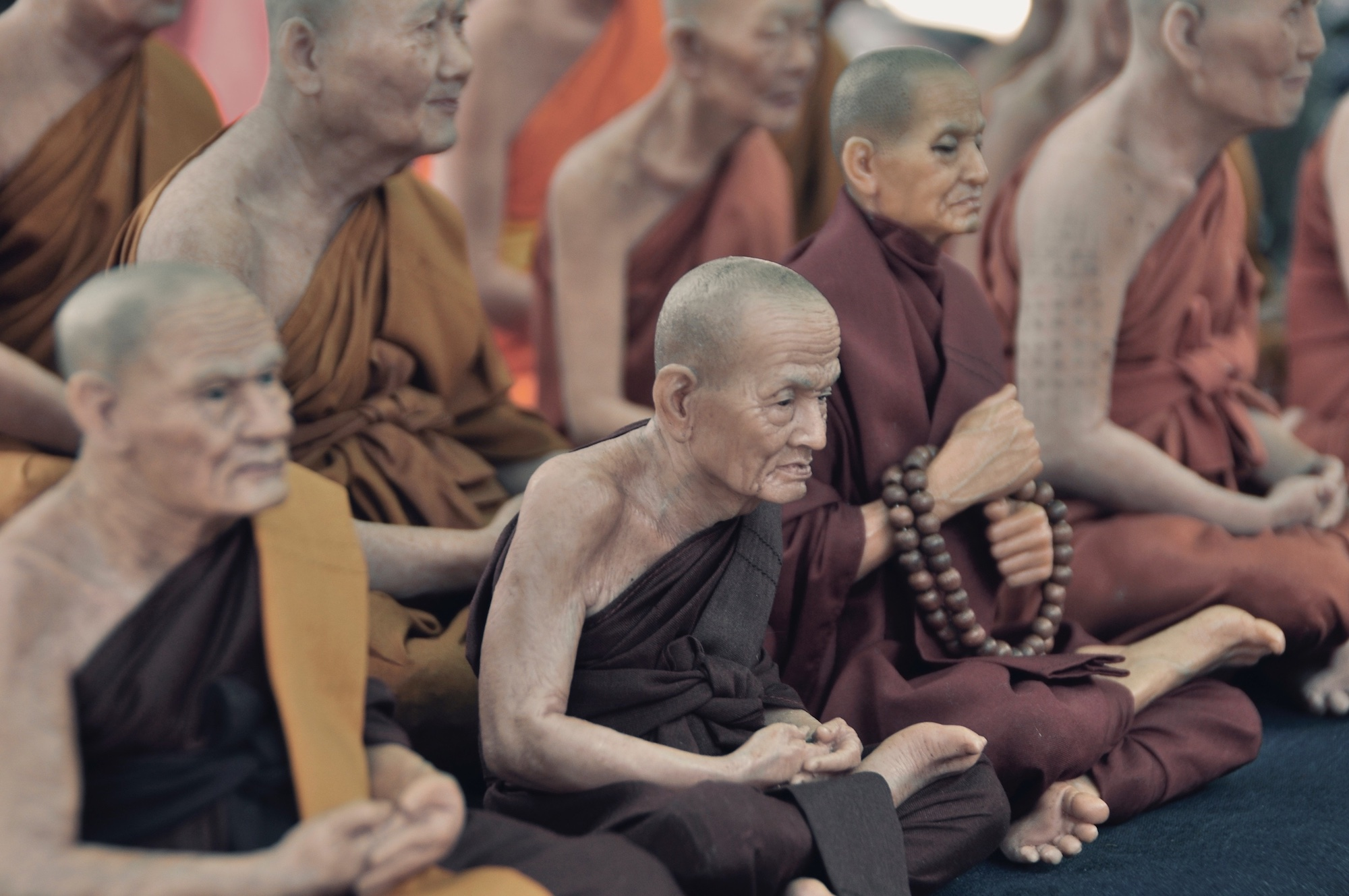 Elderly Buddhists meditating