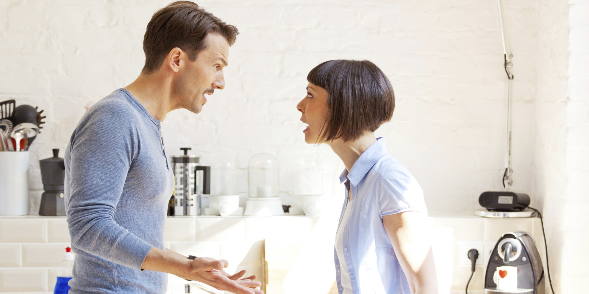 Couple screaming at each other in a kitchen