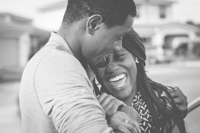African American man hugging a laughing woman