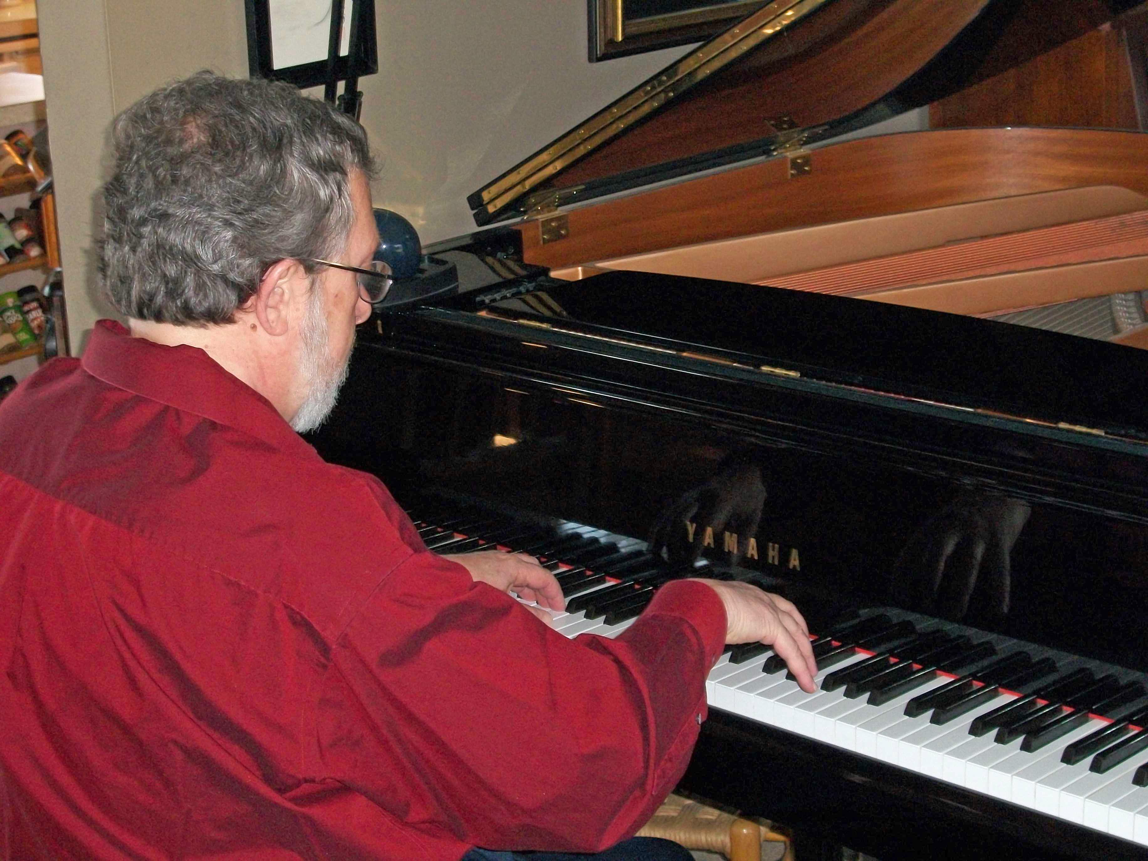 Grover Farr, Music Teacher, playing piano