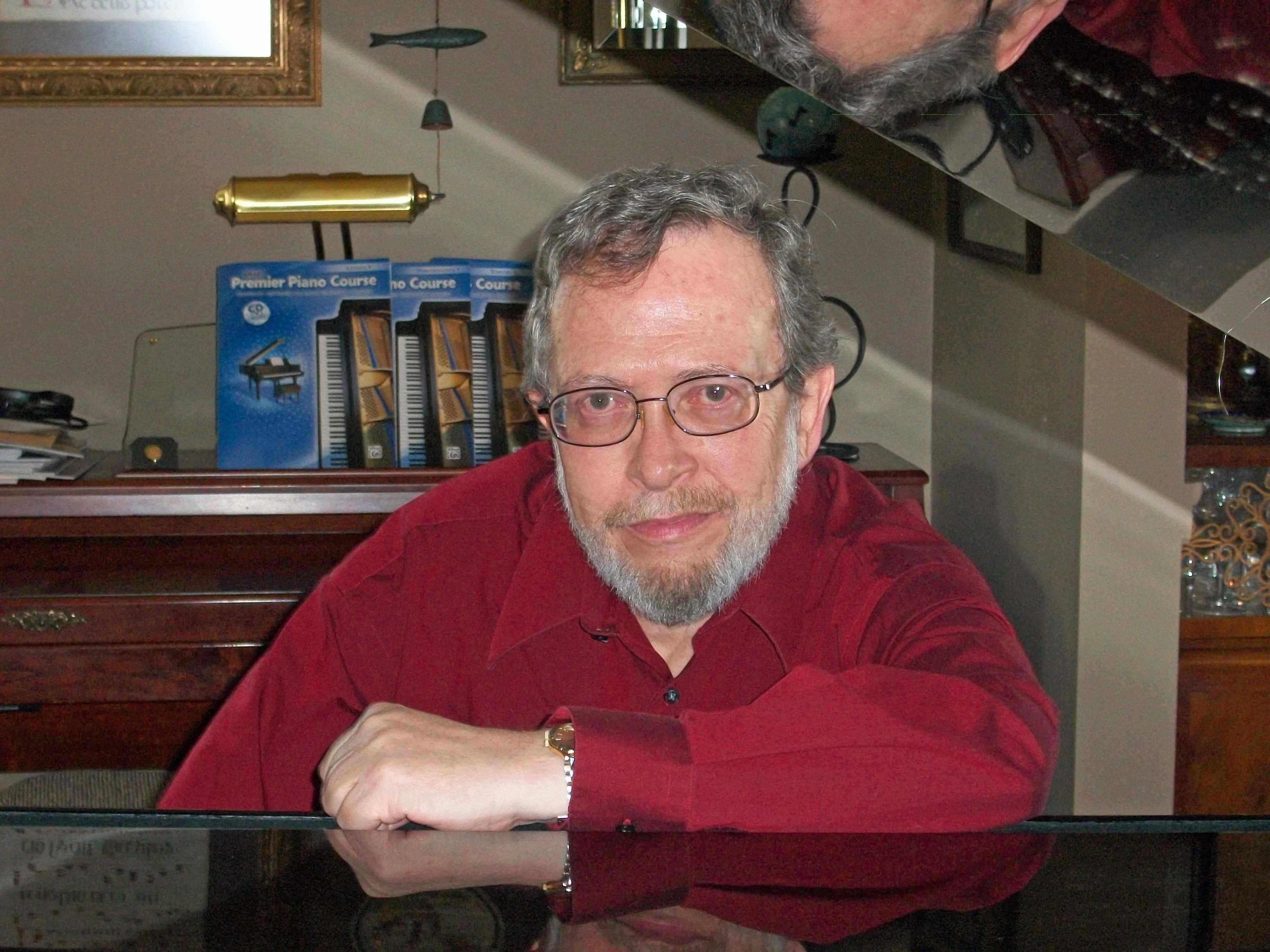 Grover Farr, music teacher sitting at piano