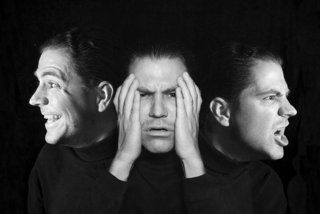 A picture of the same man in a black shirt making three different expressions.