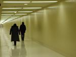 Sad Couple in Dark Tunnel