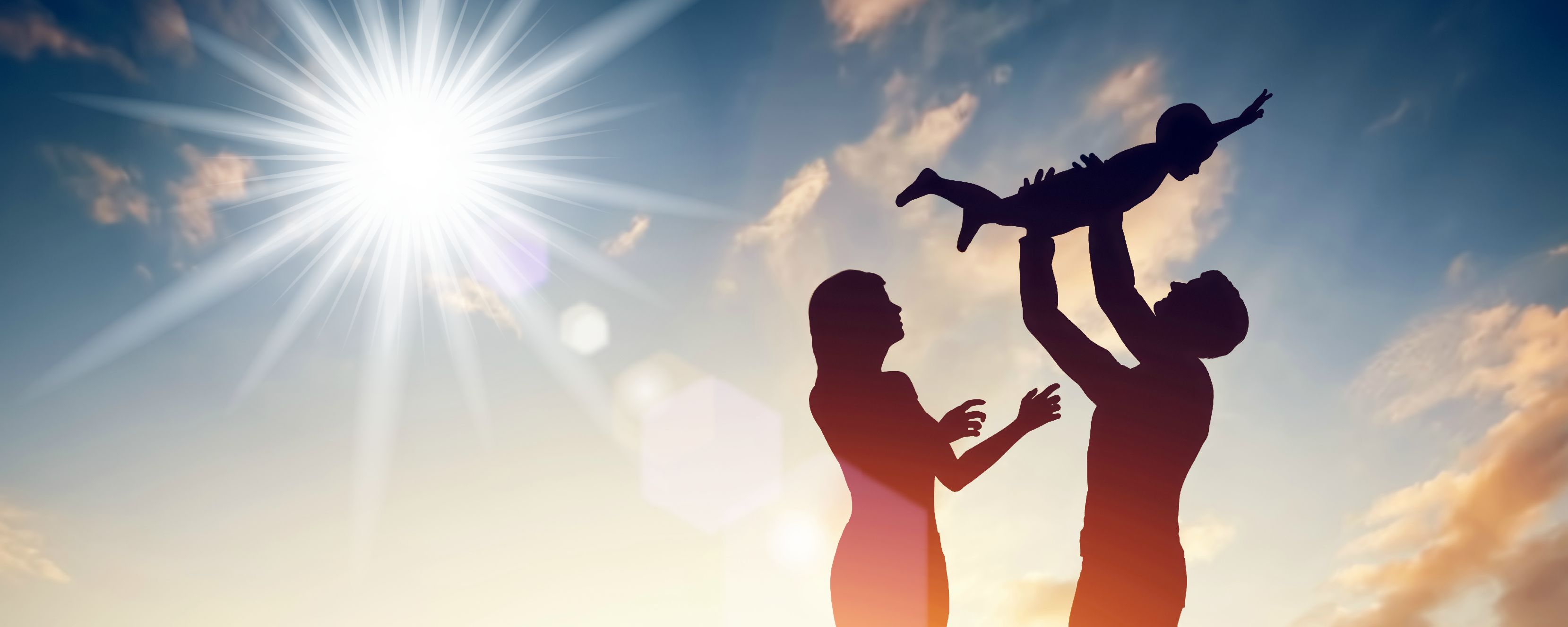 A couple with child in the light
