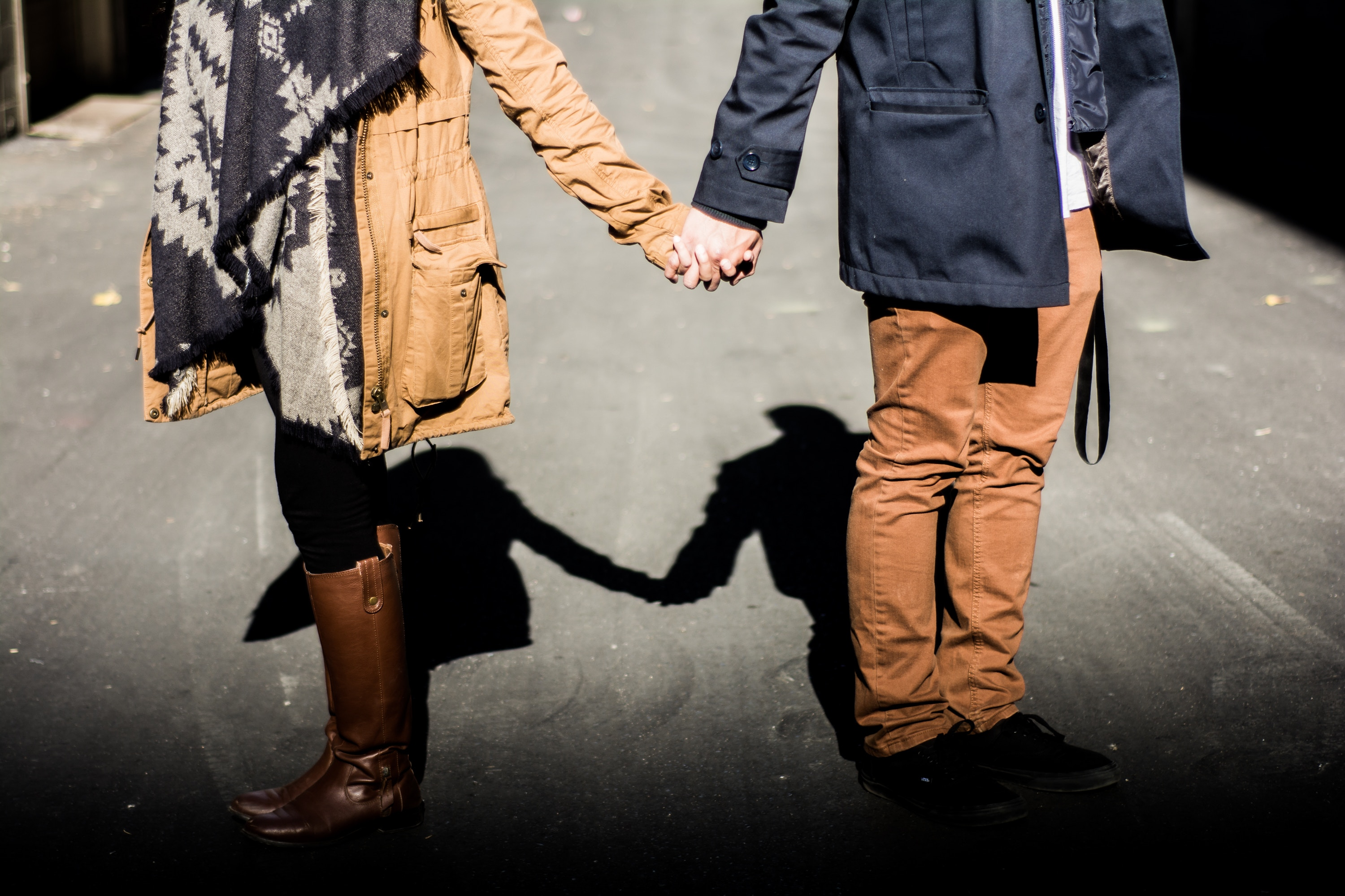 Couple walking and holding hands
